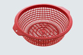 Red color plastic basket on white background — Stock Photo