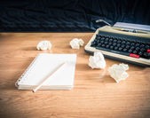 Vintage typewriter and a blank notebook of paper — Stock Photo