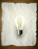 Crumpled paper with a lightbulb — Stock Photo