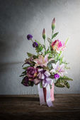 Still life with a beautiful bunch of Flowers with cobweb on wood — Stockfoto