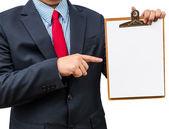 Businessman holding clipboard. Isolated on white background — Stock Photo