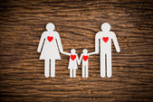Paper chain family and red heart symbolizing — Stock Photo