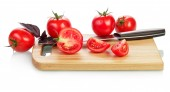 Tomatoes and knife — Stock Photo