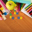 Pencils and paint with apple — Stock Photo #53157783