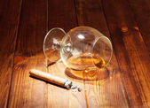 Glass and cigar — Stock Photo