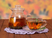 Teapot and a cup of tea — Stock Photo