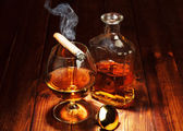 Whisky in glasses and smoking cigar — Stok fotoğraf