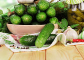 Pickled and fresh cucumbers — Stock Photo