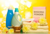 Washing powder and towels — Stock Photo