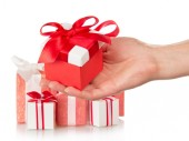Present boxes and female hand with gift — Stock Photo