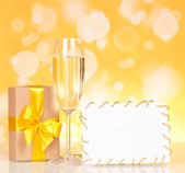 Champagne glass and empty card — Stock Photo