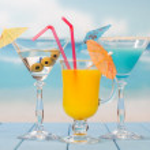 Three cocktails with umbrellas — Stock Photo #65256351