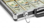 Silver case with money — Stock Photo