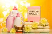 Washing powder and towels — Stock Photo