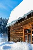 Beautiful wooden house in a winter sunny day — Stock Photo