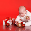 Baby boy playing with christmas decorations — Stock Photo #55001073
