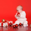 Baby boy playing with christmas decorations — Stock Photo #55001087