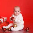 Baby boy playing with christmas decorations — Stock Photo #55001093