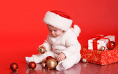 Baby boy with presents — Стоковое фото