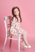 Girl Sitting on chair — Stock Photo