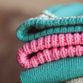 Stack of knitted sweaters — Stock Photo