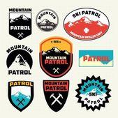 Set of ski patrol mountain badges — Stock Vector