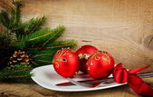 Christmas plate bauble pines wooden surface — Stock Photo