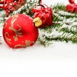 Closeup view of red christmas bauble with gifts — Stock Photo #58447931