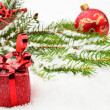 Closeup view of red christmas bauble with gifts — Stock Photo #58449019