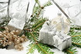 Silver christmas gifts with silver ribbon and needles fir with r — Стоковое фото