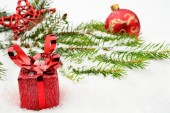 Closeup view of red christmas bauble with gifts — Stock Photo