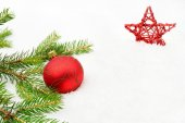 Red christmas baubles with red star and needles fir on snow — Stock Photo