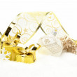 Golden christmas gifts, white bauble ribbon and rowan on snow — Stock Photo #58525255