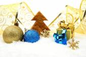 Golden and blue christmas decoration on snow with cookie tree — Stock Photo