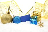 Golden and blue christmas decoration on snow with wishes card — Stock Photo
