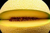 Close-up shot of melon galia notched isolated black — Stock Photo