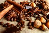 Aromatic assortment of chocolate,coffee,anise, and cinnamon on l — Stock Photo