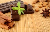 Set of chocolate,anise and cinnamon with sage on wooden mat — Stock Photo