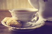 Old-style kettle,two cups of tea with cookies vintage effect — Stock Photo