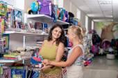 Young beautiful girls buy stationery  — Foto Stock