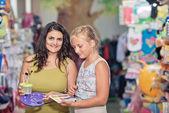 Young beautiful girls buy stationery  — Stock Photo