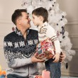 Man gives his son New Year gift — Stock Photo #61884359