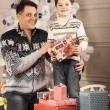 Man gives his son New Year gift — Stock Photo #61884363