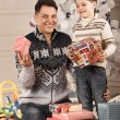 Man gives his son New Year gift — Stock Photo #61884371