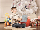 Boy with New Year presents — Stock Photo