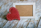 Picture frame with red heart — Stock Photo