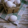 Chicken eggs on a wooden background — Stock Photo #64094411