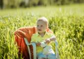 Little boy on the lawn, a child for a walk outdoors — Stock Photo