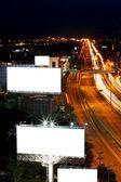 Night city traffic and billboards — Stock Photo