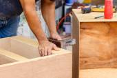 Carpenter make new furniture for house — ストック写真